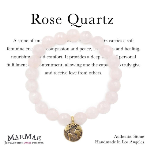 rose quartz stone bracelet with gold pewter earth charm on information card