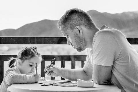 kids spending time with parents reading