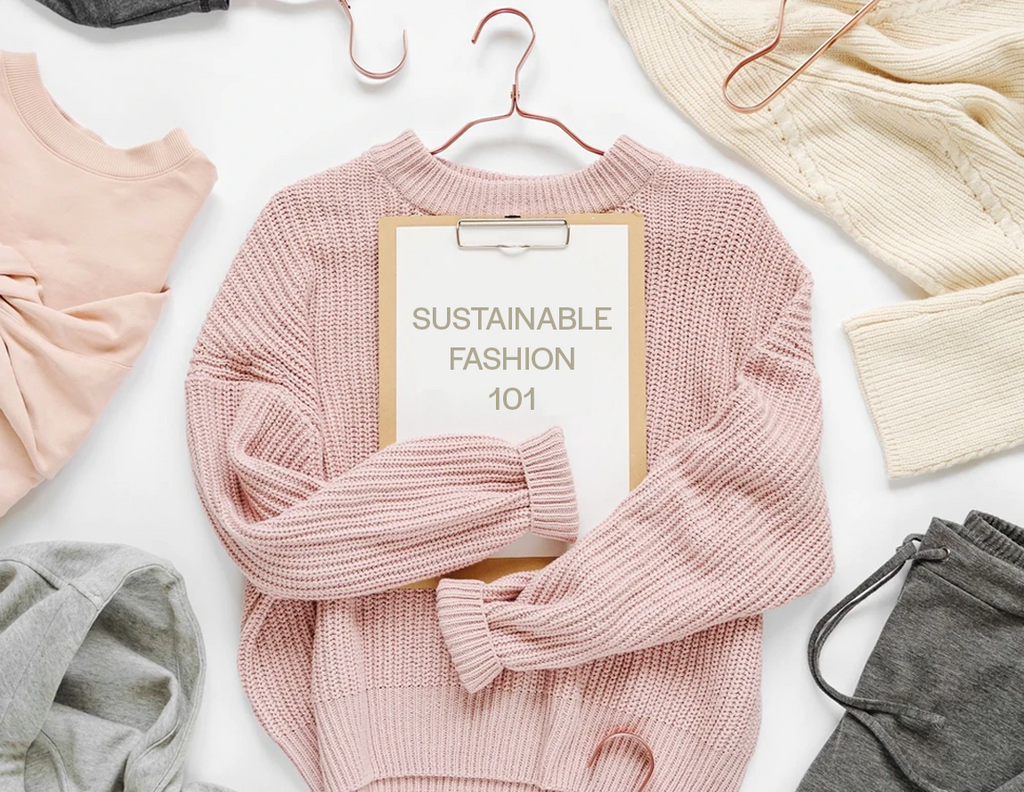 "Environmentally Friendly made Sweater hugging a clip board saying ""Sustainable Fashion 101"". Other wool woven and organic cotton clothing items surround the sweater. This is a PSA for parents who care about making environmental and eco-conscious lifestyles. Collection can be found for Designer Kids Wear"