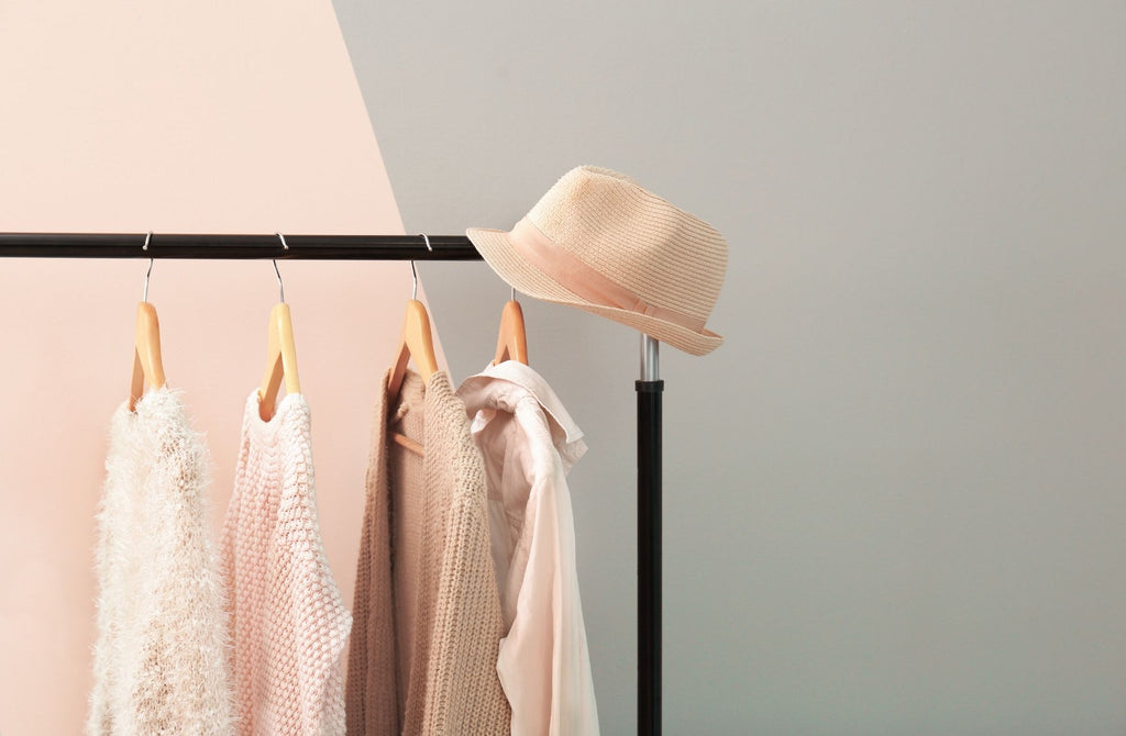 Apricot and beige clothes hanging on rack with nice background
