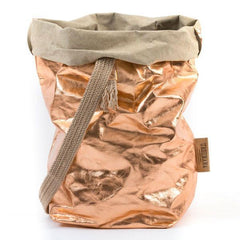 washable paper fiber tote bag in reflective rose gold color. One finely weaved shoulder strap