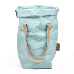 washable paper fiber tote bag in light blue color. Two finely weaved shoulder strap