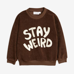 Mini Rodini. Cute Cozy Brown Sweater with text Stay Weird. Organic and Environmentally Friendly Sweater in Designer Kids Wear.