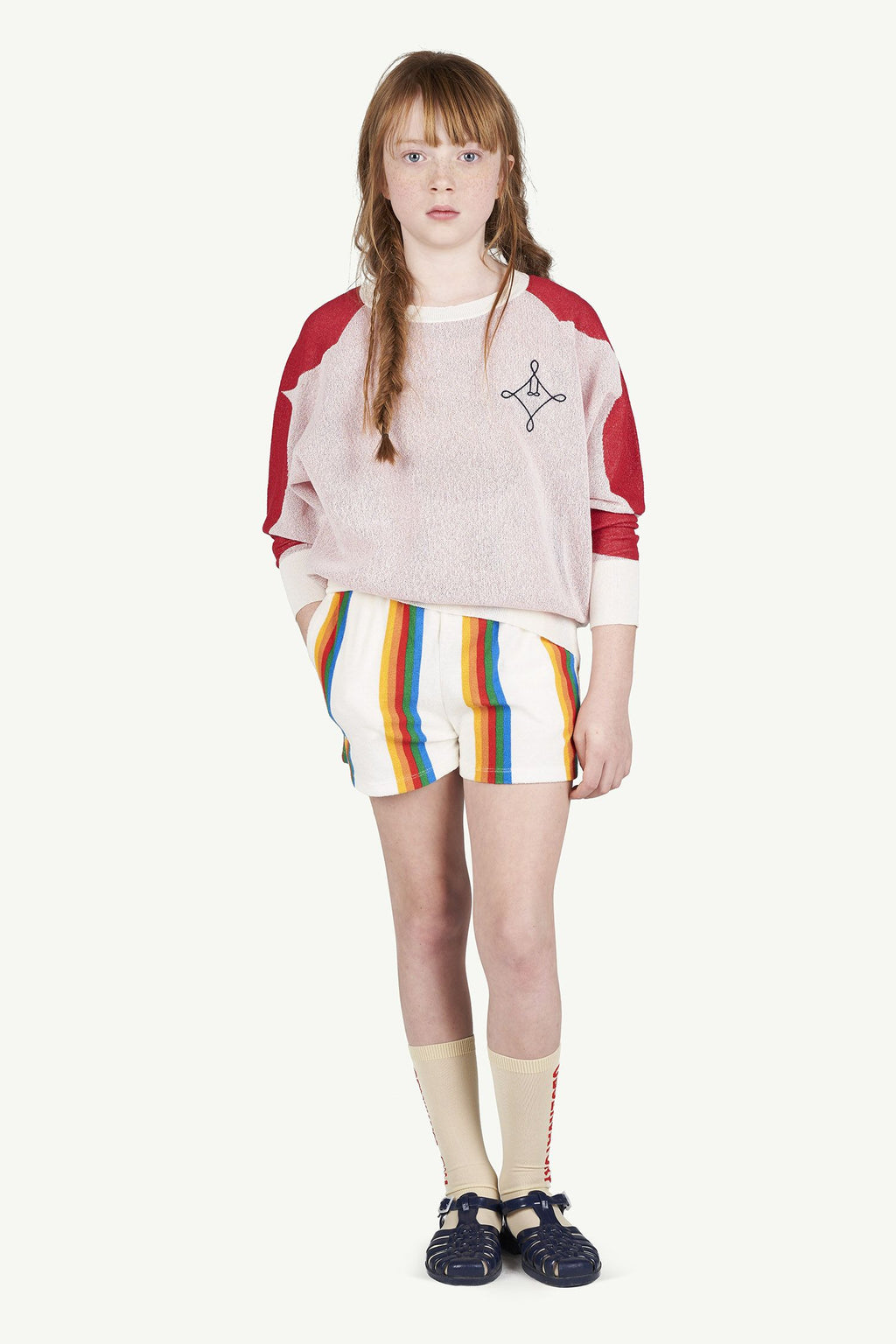Female model wearing sweatshirt, shorts and biege socks made by The Animal Observatory