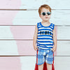 Model wearing Blue Stripe Rebel Tank Top with blue gingam shorts