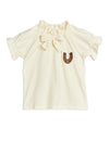 Beautiful ivory cotton blouse with elegant ruffles, puff sleeves, and a horseshoe embroidered at the front.