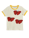Beautiful ivory cotton T-shirt with beautiful butterfly embroideries on the front and fun yellow neckline trim.