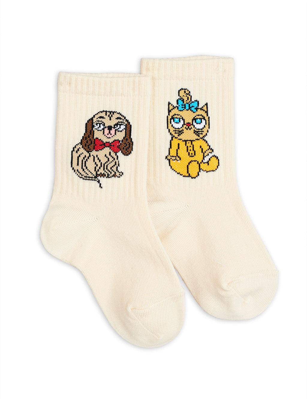 Girls and boys ivory socks made with soft organic cotton. One sock has a yellow cat motif, and the other has a brown dog. Both classic avatars of the children clothes' designer Mini Rodini