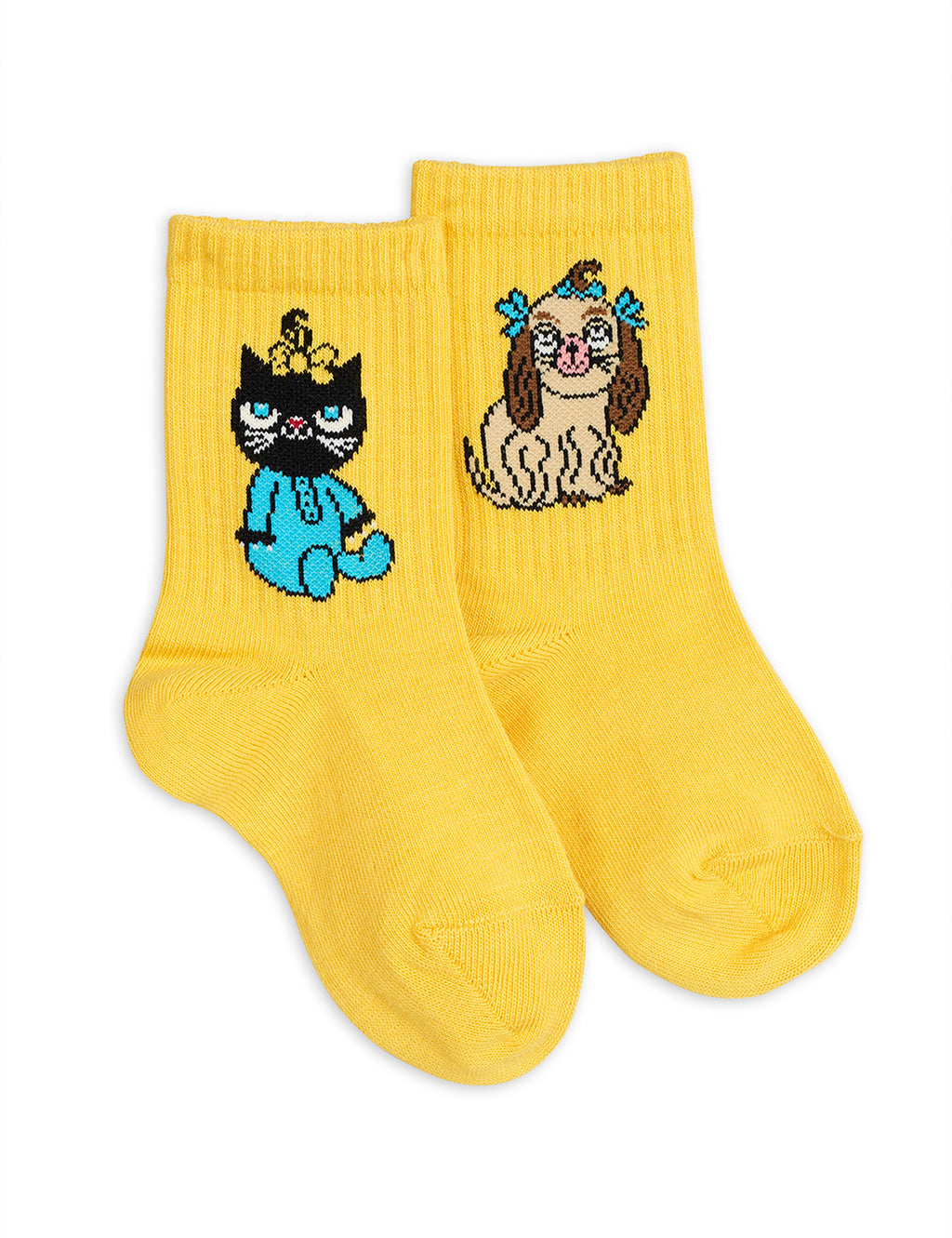 Girls and boys yellow socks made with soft organic cotton. One sock has a yellow cat motif, and the other has a brown dog. Both classic avatars of the children clothes' designer Mini Rodini