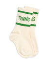 Girls and boys green socks made with soft organic cotton. They have 'Tennis' printed in white lettering and stripe patterns around the top.