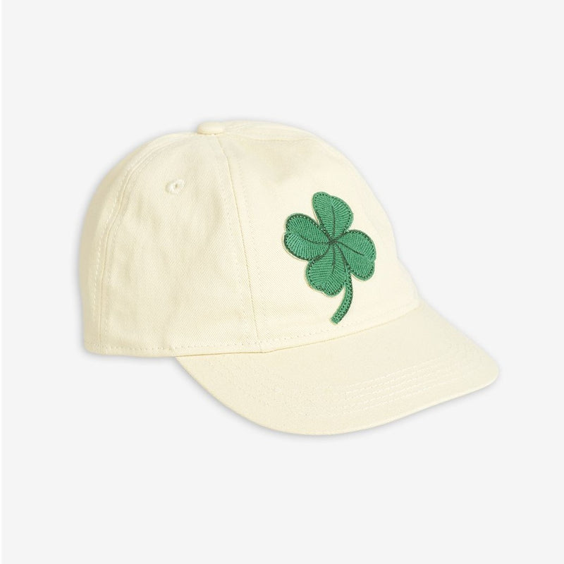 Girls and boys ivory cap with a green lucky clover embroidery on the front and a logo on the back