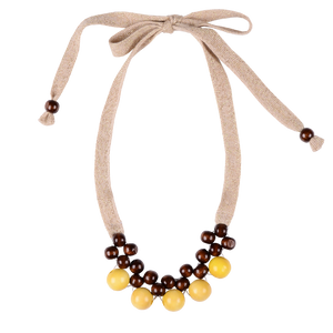 Beaded wooden balls on glittery knit ribbon ties. Made by Imoga