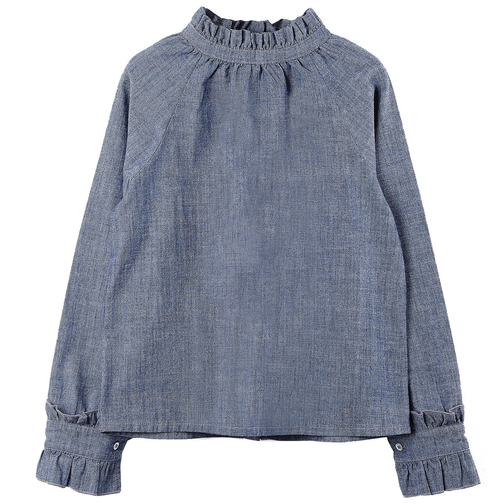 Timeless chambray blouse with ruffle detail collar and cuffs. Created as a true original design by the stylists and designers at Émile et Ida. 100% cotton. Made in Portugal.