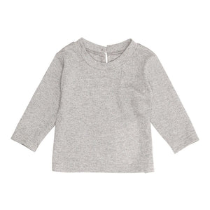 From Scandinavian designer Christina Rohde, this light grey long sleeve may seem simple in design, but shimmers a subtle sparkling detail. Made with soft materials for comfort, and has a button clasp at the back for easier dressing.