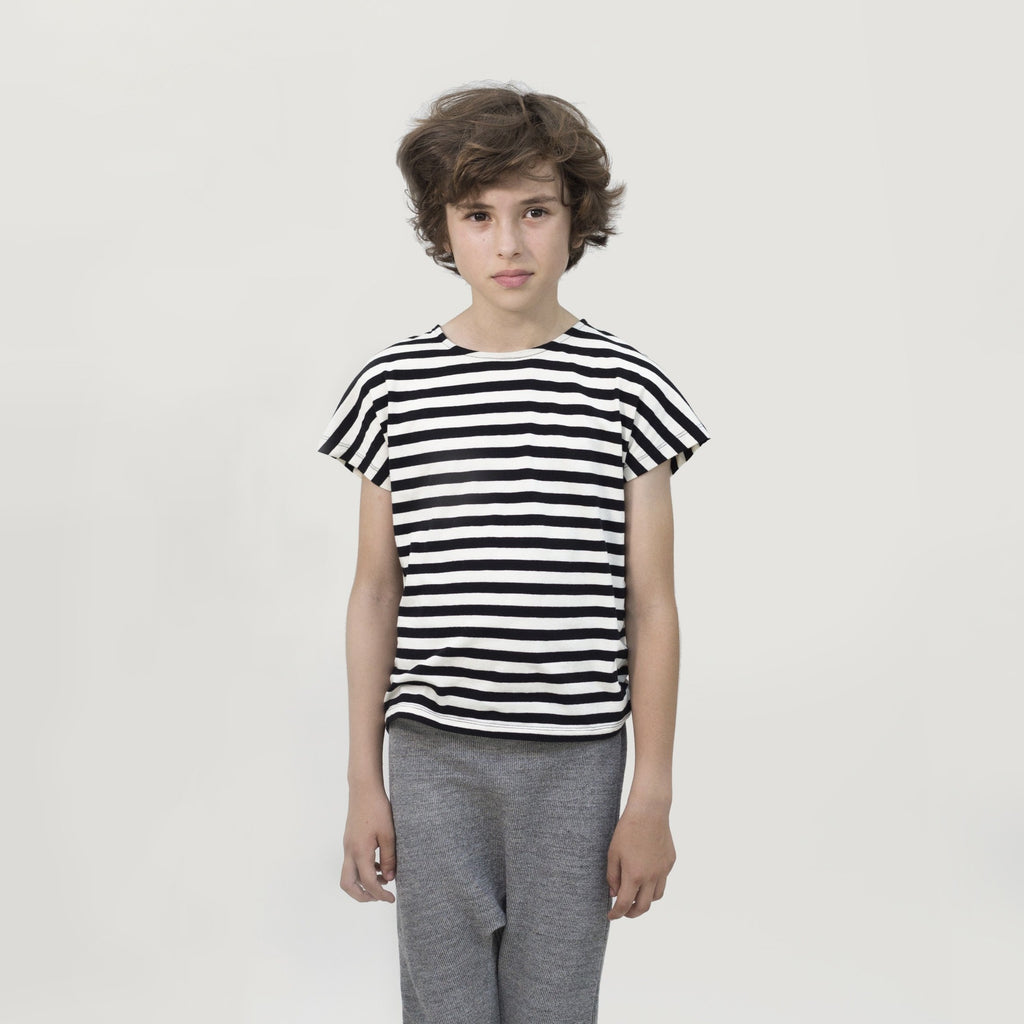 Model wearing striped T-shirt designed by Motoreta