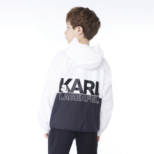 White and black half zip windbreaker jacket. Lightweight and breathable material with a large black white logo on the back with Karl Lagerfeld's silhouette. Karl Lagerfeld was a fashion designer, and creative director of Fendi and Chanel.