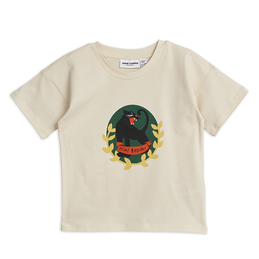A fun ivory organic cotton T-shirt with a distinctive panther motif badge at the front.