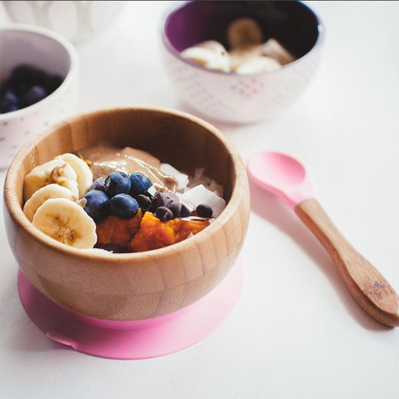 Baby bamboo pink suction bowl with bamboo spoon. Organic dining ware for baby or toddler.