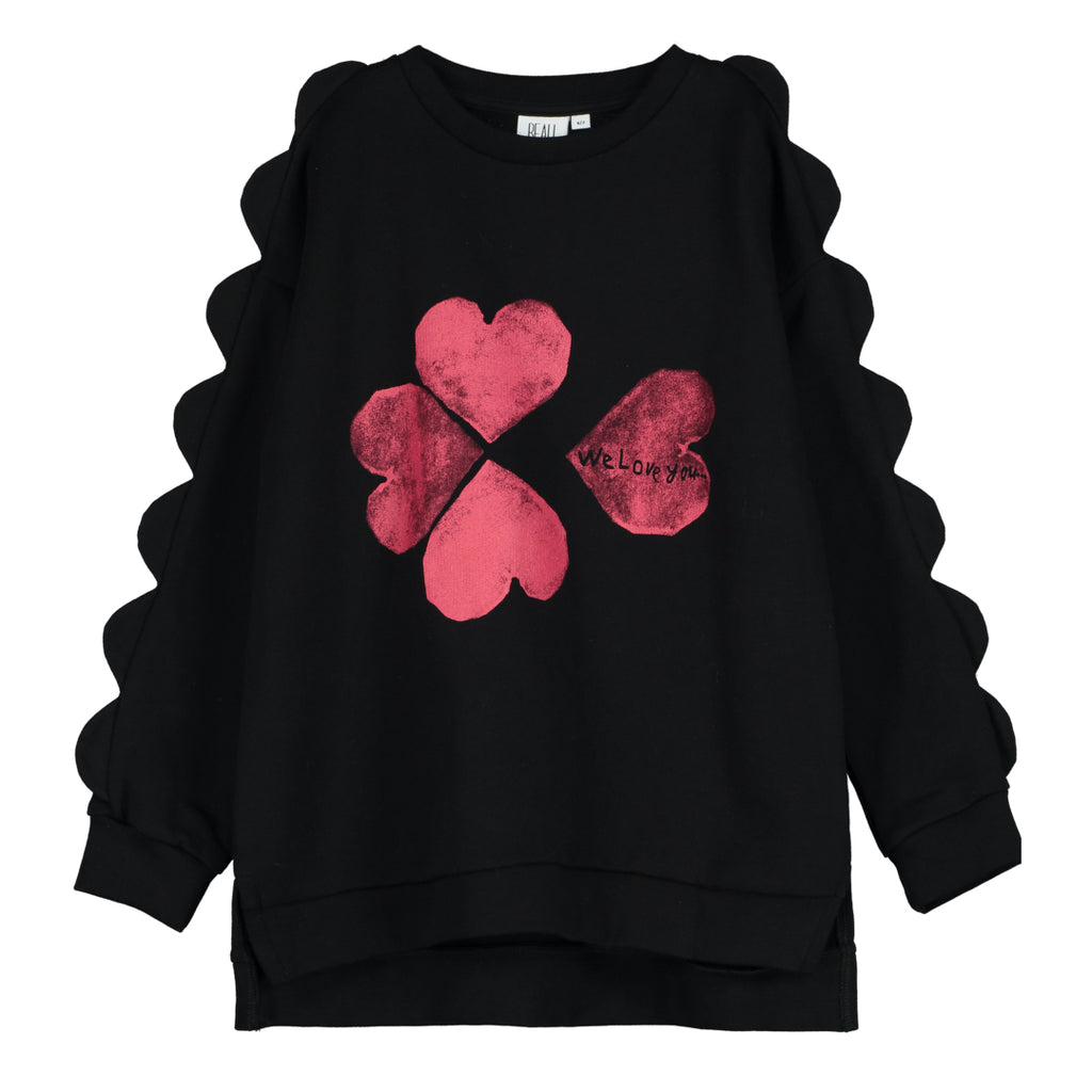 "This black sweater is printed with a red heart in the shape of a four-leaf clover, with scallop trim on the sleeves. ""we love you"" printed at the back, and ribbed trim on the neckline, cuffs, and hem."