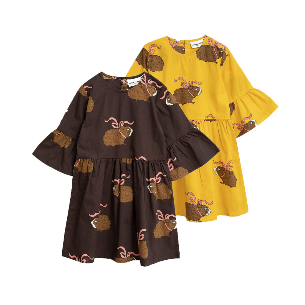 Cotton woven dress with elegant printed guinea pigs all-over. The dress is styled with bell sleeves, a gathered waist, and a flared skirt. Comes in color Brown or Yellow.