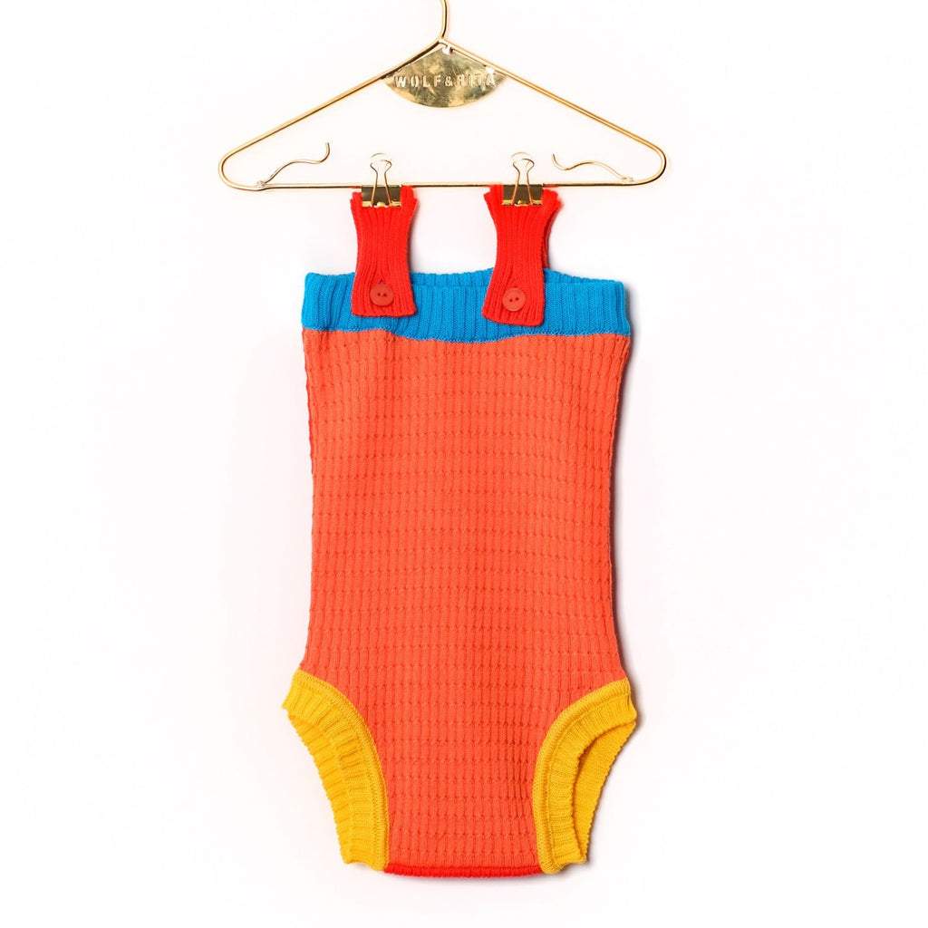 Red, blue, yellow, fun color blocking crochet bodysuit for your baby! Let your baby enjoy a cute style summer!  Made by Portugese brand Wolf & Rita, they cultivate the savoir faire and inspiration of the past to create children's wear for everyday use. Focusing on the finest quality fabrics & trimmings for your young one.