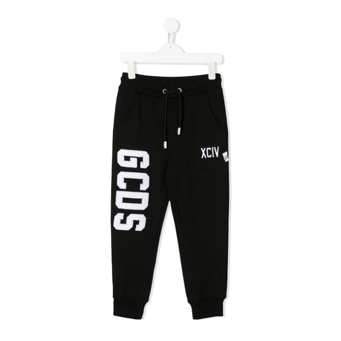 Black cotton embroidered logo sweatpants from GCDS kids featuring an embroidered logo to the front, an elasticated drawstring waist, a relaxed fit, elasticated cuffs and a pull-on style.