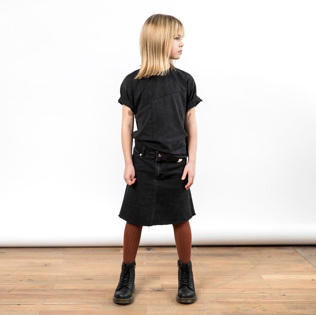 Girls black denim skirt with metal rose gold notions. Knee length, A-line style.