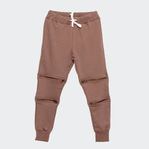 Children's I dig denim sweatpants in rosewood color. Regular fit with ribbed waistband and cuffs. Tape style waistband drawstring and zipper details below and above each knees.