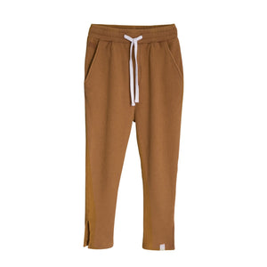Children's I dig denim comfortable lose fit pants in rusty brown. small grid textured fabric. Elastic waistband with drawstring, side pockets, and cuff slits.