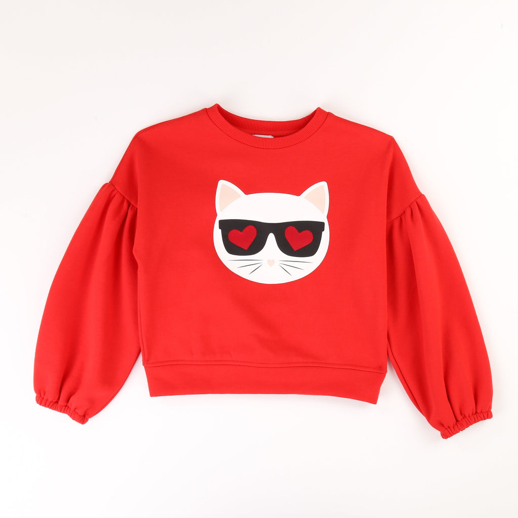 A fun and bold red coloured sweatshirt with Karl Lagerfeld's iconic cat, Choupette illustrated on the front.