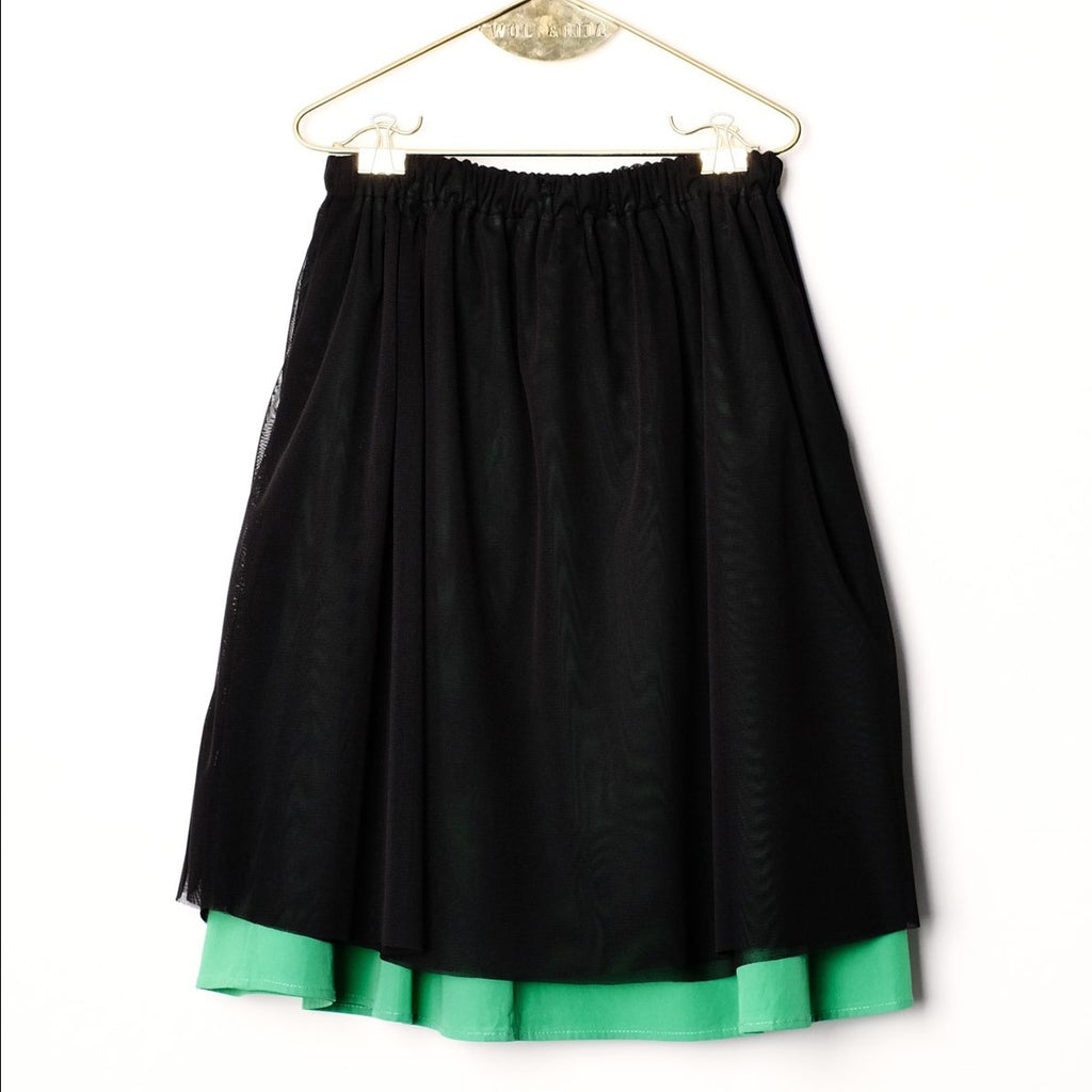 Wolf & Rita Black Sheer Green Layer Skirt with a layer of black sheer fabric on the outside, and green cotton skirt on the inside. A comfortable elasticated opening and a flared style.