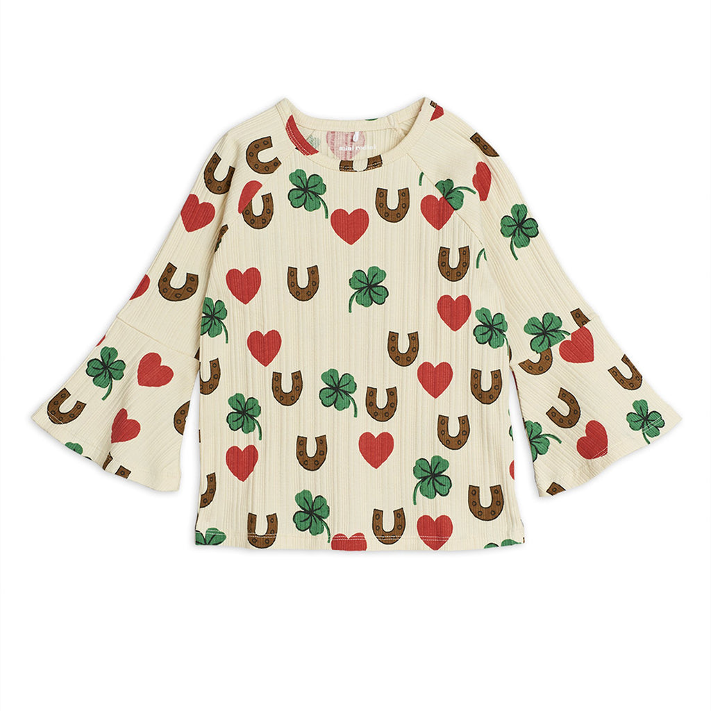 Boys and Girls Organic Cotton Long Sleeve Shirt with red hearts, green clovers, and brown horseshoe print all-over. Designed by Mini Rodini, a Scandinavian brand into eco-friendly and sustainable products.