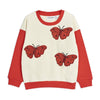 Comfortable ivory cotton sweatshirt with elegant butterfly embroideries at the front and accented red sleeves.