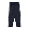 Molo's new collection is inspired by how we can all be different together. Altor is a pair of dark blue track pants with the statement 'Different Together' embroidered down one side of both legs. Altor also has an elastic waist and zip pockets at the sides.