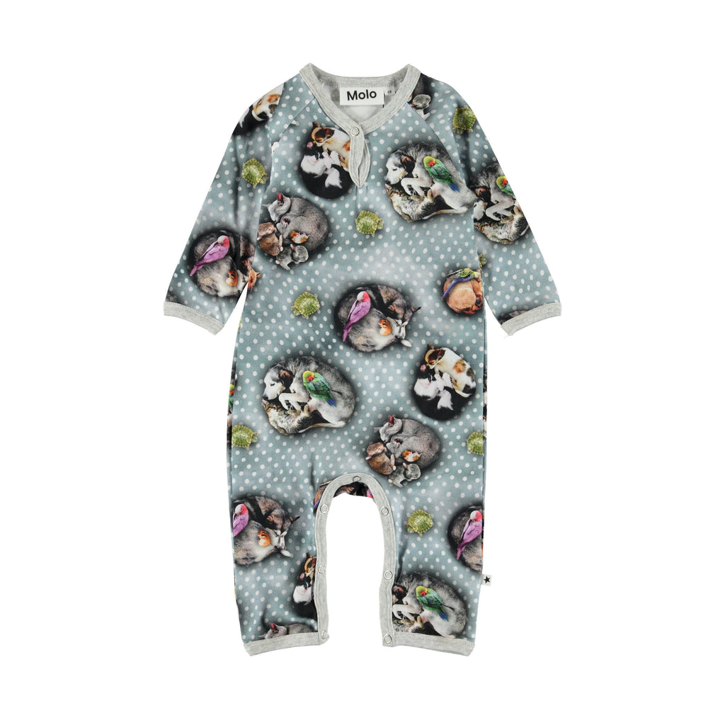 "Fiona is a baby romper in the ""Oriental Peacocks"" print with a pink edge tape. It has easy snap closure at the neck and crotch."