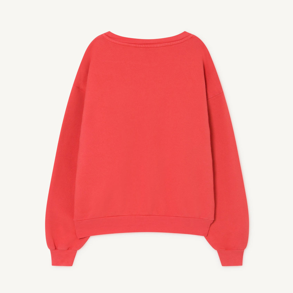 The back of red baggy style sweatshirts with round neckline and baggy sleeves.