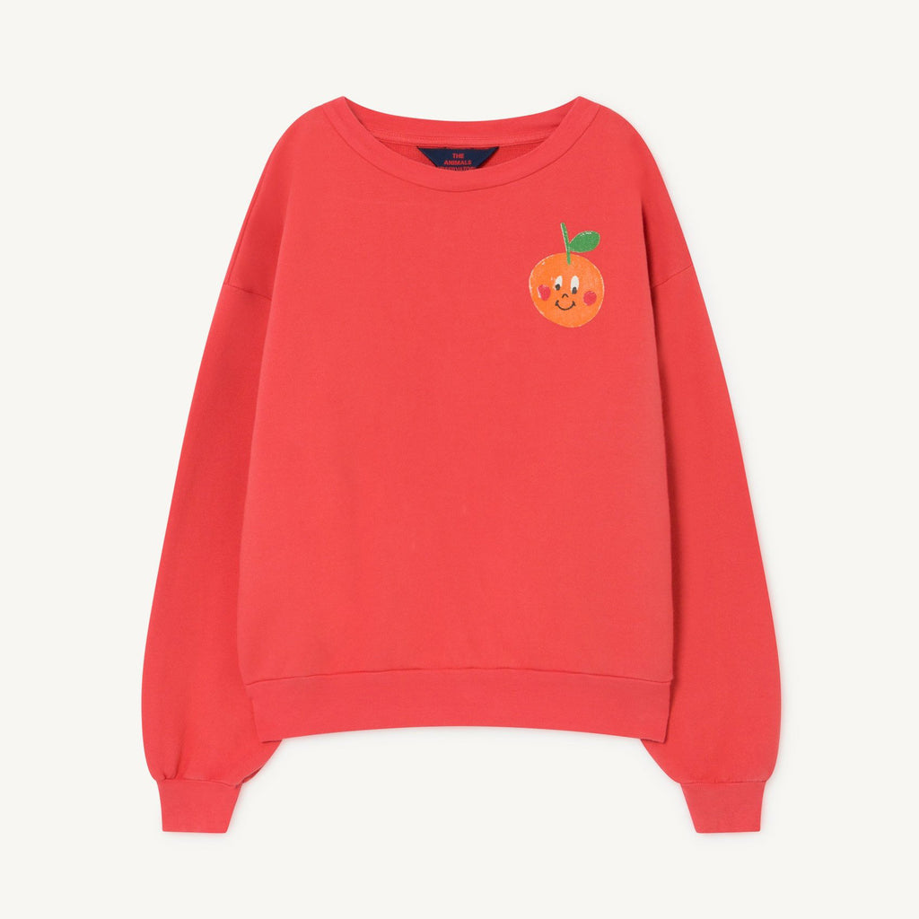 A red baggy style sweatshirts with a smiley tangerine motif print in the corner. It has a round neckline and baggy sleeves.