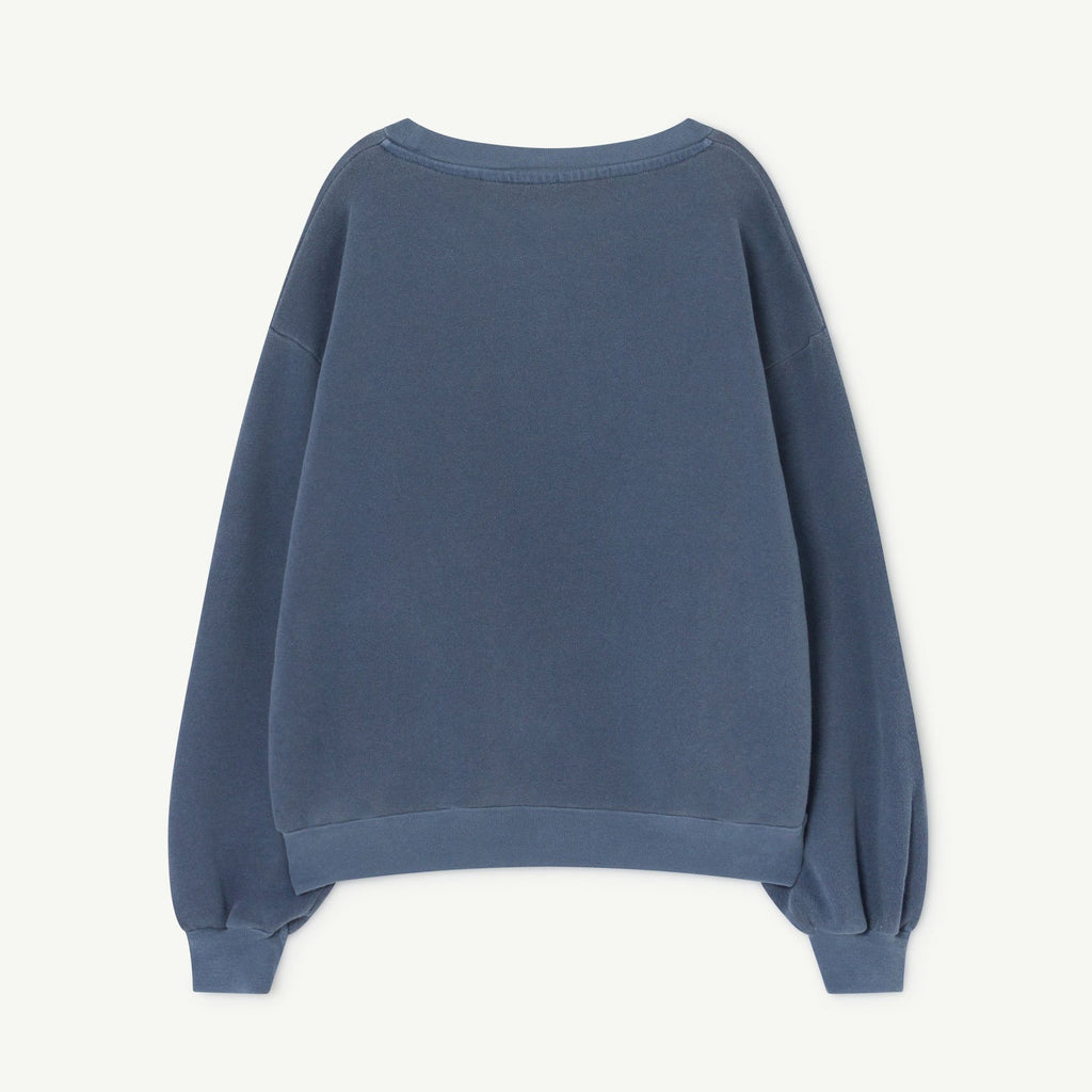 The blue star sweatshirt with a dropped shoulder gives this cozy sweatshirt a relaxed fit with its wide, rounded neckline and ribbed cuffs and hem. Made from cotton and star motif on the front.