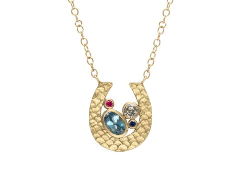 Alison Macleod  Fairtrade 18ct gold, aquamarine, ruby, sapphire and diamond Catkin Happenstance Horseshoe necklace £2,360, available at The Jewellery Cut Shop