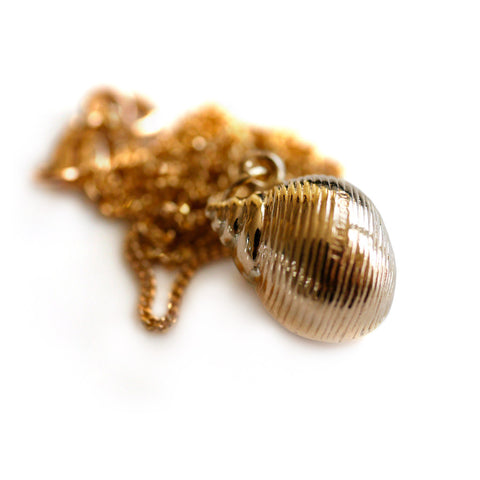 Gold Glorious Gold: 1968 Conch Shell Pendant
