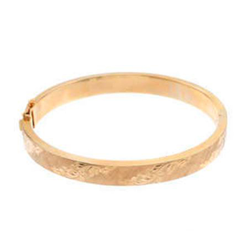 Gold Glorious Gold: 1964 Bangle