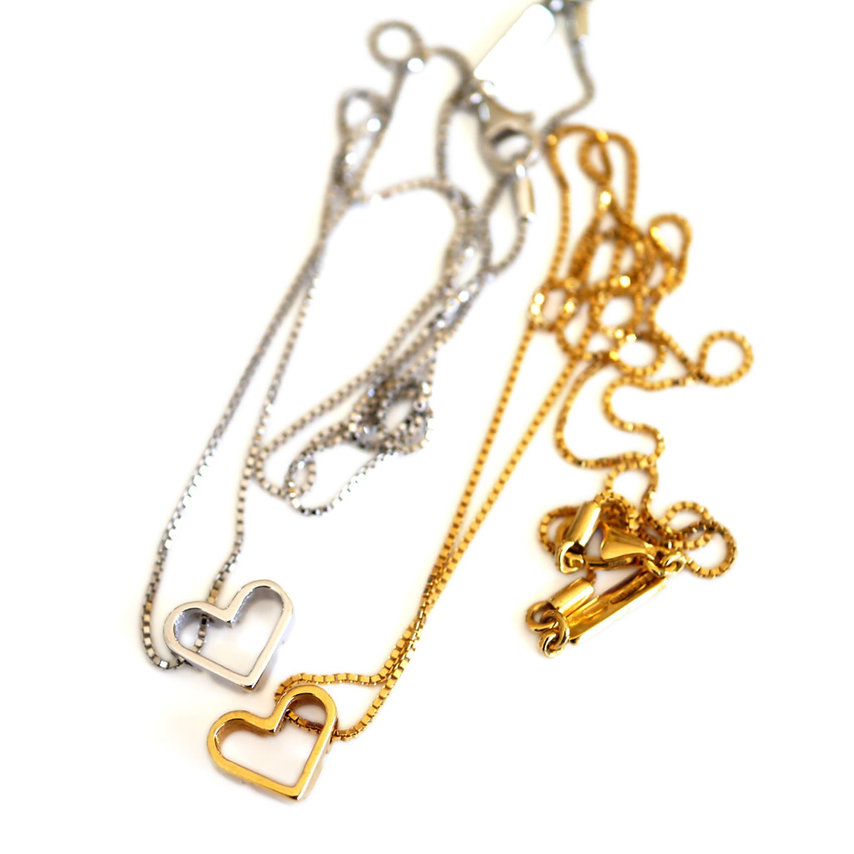 Gold Glorious Gold: Beating Heart Necklaces