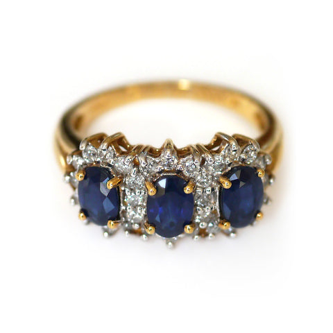 Classic Elegance: Three Oval Sapphire and Diamond Ring