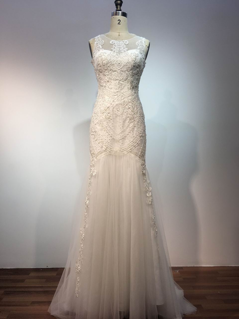 11018 F Sleeveless illusion neckline wedding dress