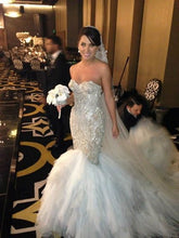 Strapless fit-and-flare wedding dress inspired by Jaton Couture