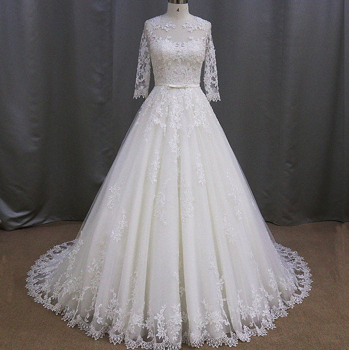 3/4 Sleeve Lace Wedding Gown with illusion neckline from Darius USA