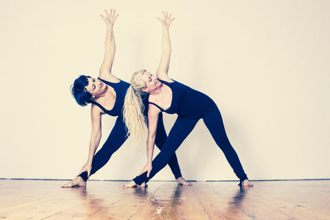 Two women in yoga triangle pose - Sudsy Style - beer fashion for your beer passion
