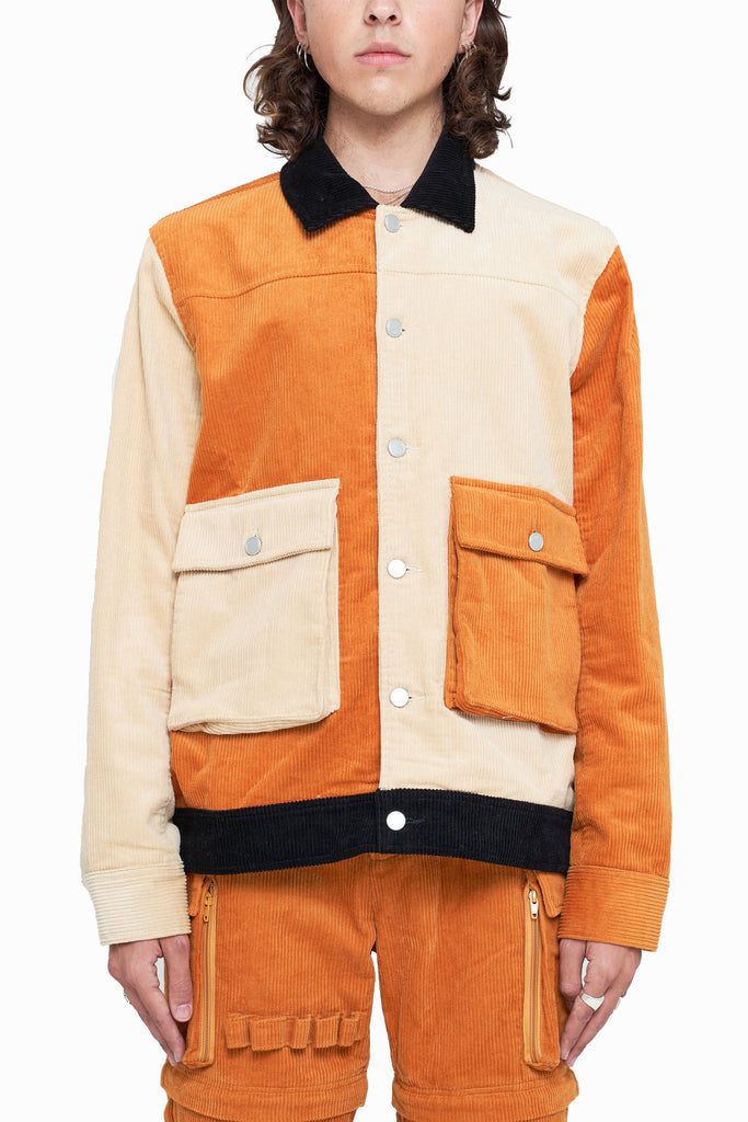 The three-toned corduroy jacket is the perfect piece to add a touch of classic yet subtle style to your rotation. Constructed from pure cotton corduroy and dressed in Apricot Brown, Oatmeal, and Jet Black, this piece is detailed with a classic collar and custom
