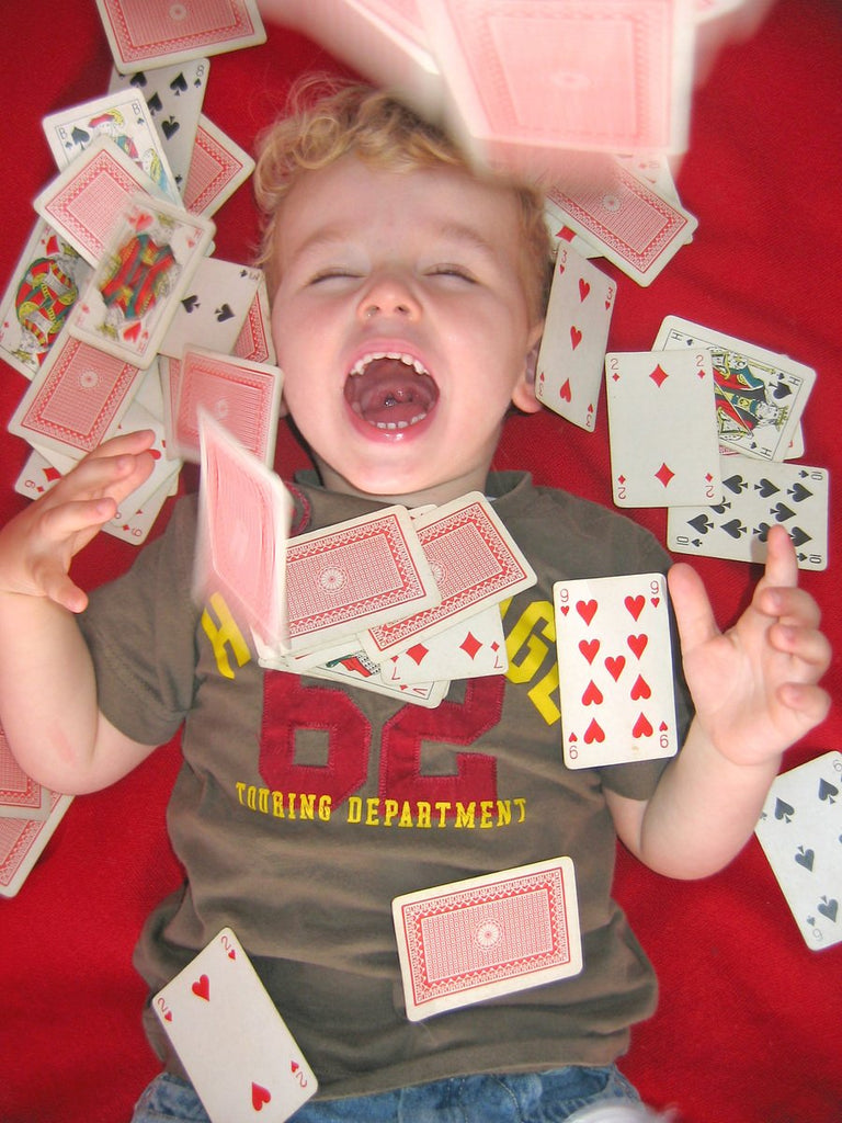 Kid with Playing Cards - Caption Contest!