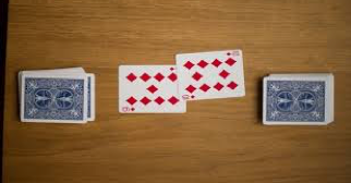 (In this round, the player with the 10 will win and take both cards)